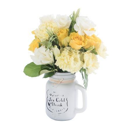 Mason Jar of Mixed Lemon and White Blooms
