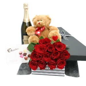 One Dozen Red Roses Teddy Chocolates And Chandon